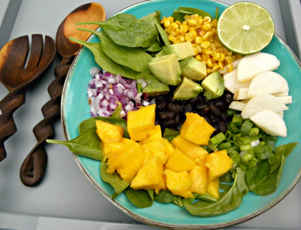 Indo- Mexican fusion salad recipe with curried beans, mango, jicama an dspinach to nmae a few :)