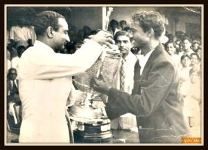 Pappa,  Mr. Ram Rege ,(on the right), in his college days, as the Captain for the Bombay University Cricket Team, receiving the winning trophy from the legendary cricketer Vijay Merchant
