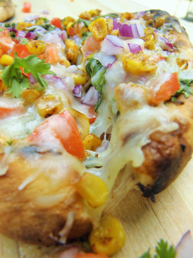 #Indiancuisine #Grilled #Naan #Pizza with #Chutney #sauce, ,#cheese and#summerbounty #toppings of #corn, tomatoes, onion and#cilantro