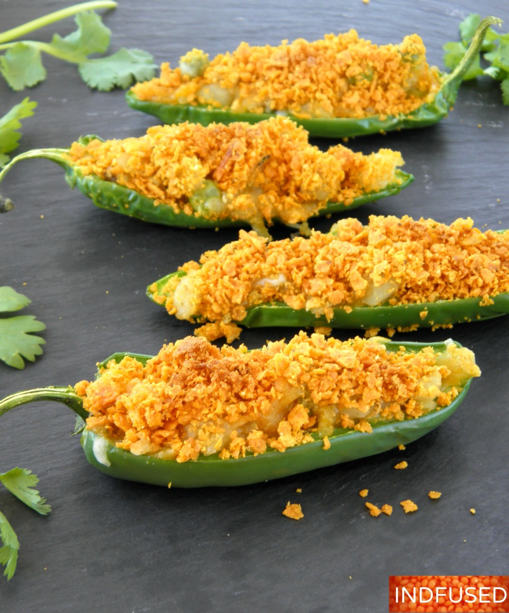 Non- fried, stuffed jalapenos with an Indian spiced potato and pea filling that is cheesy, crunchy, spicy and yummy!