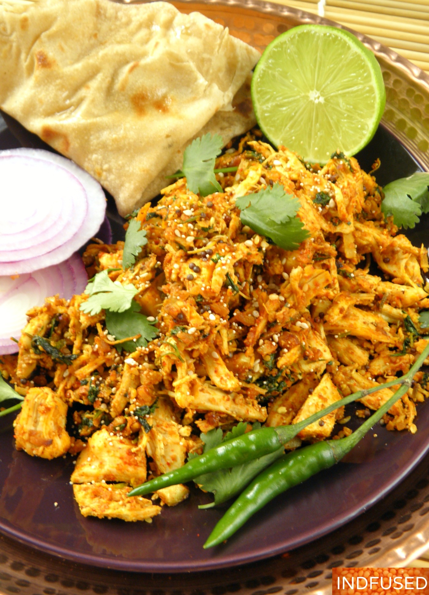 Simplified, shortcut, skinny recipe for a distinctly flavored tangy ,spicy Indian chicken entree, made using skinless boneless rotisserie chicken breast meat.