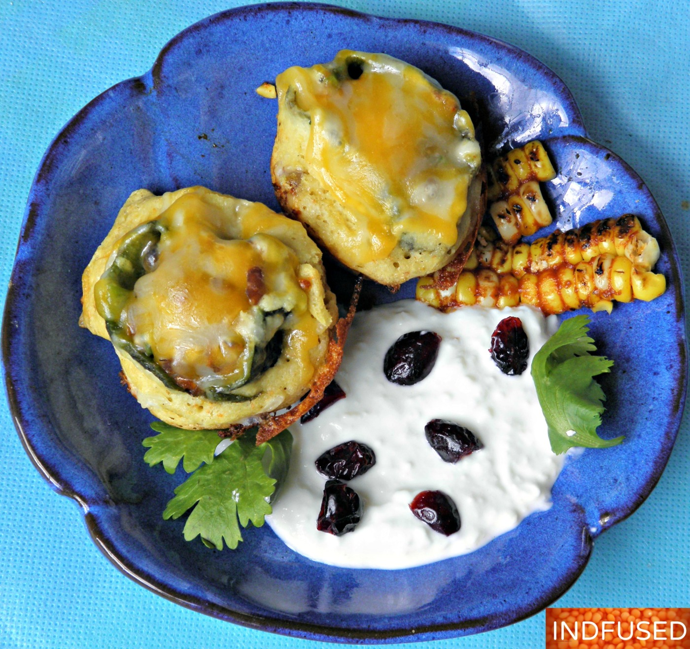 Indian fusion recipe for figure friendly, savory, crispy Chili Rellenos Bocados served with cotija cheese sauce!