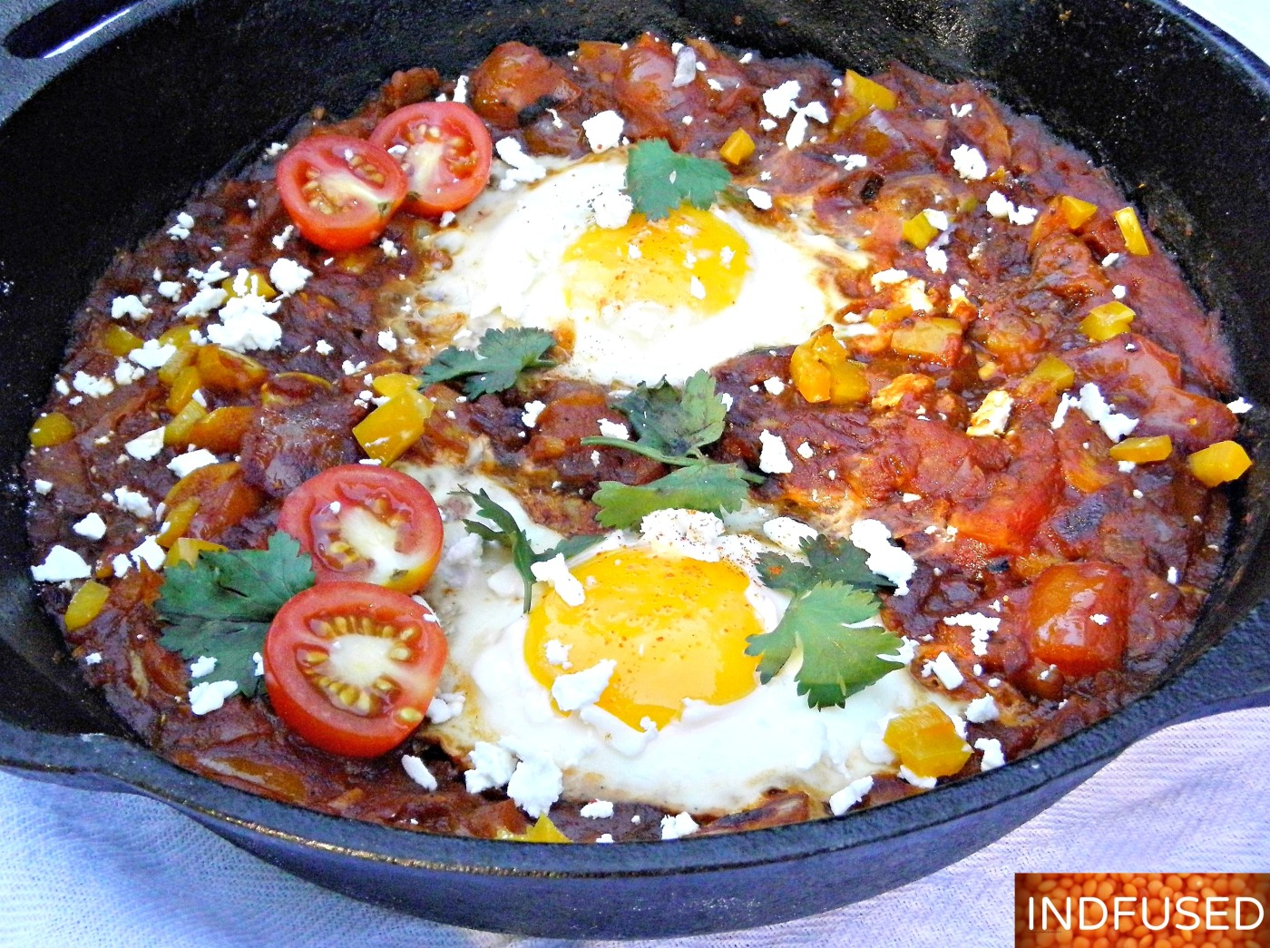 Indian fusion recipe for Shakshuka with #Hunts tomato paste, #MTR garam masala, #eggs, and #Athenos feta cheese