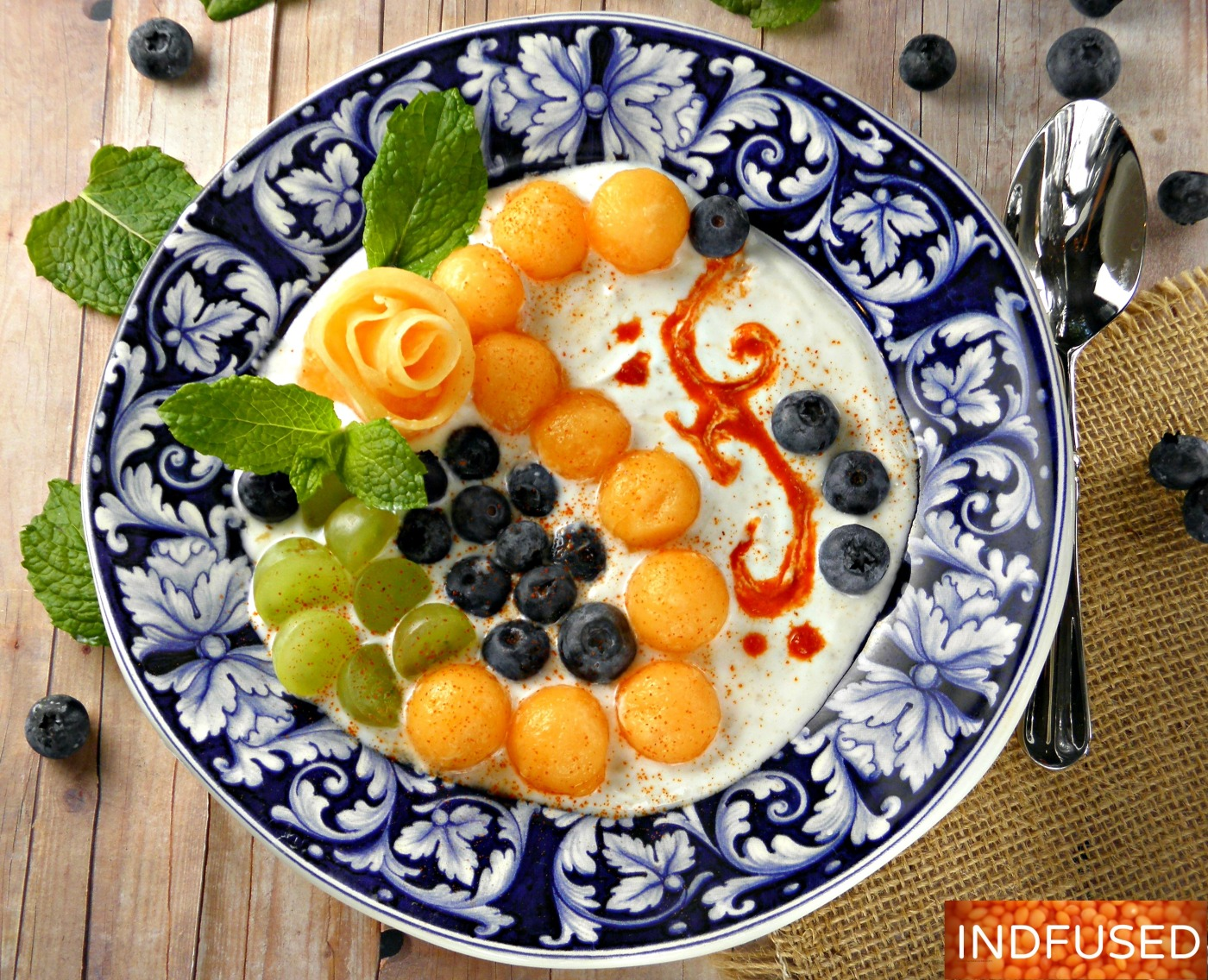 Savory, Indian fusion recipe for melon and fruit raita with Greek yogurt, mint and smoky cumin. easy versatile recipe.