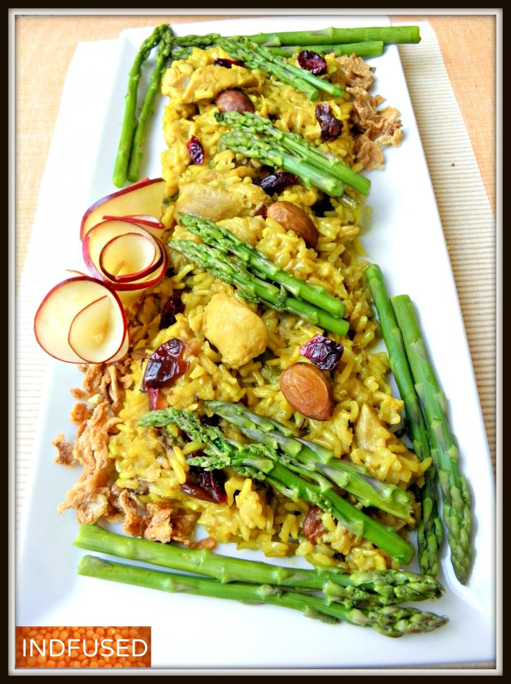 Indian recipe for chicken and asparagus pilaf with brown Basmati rice , almonds, craisins and coconut