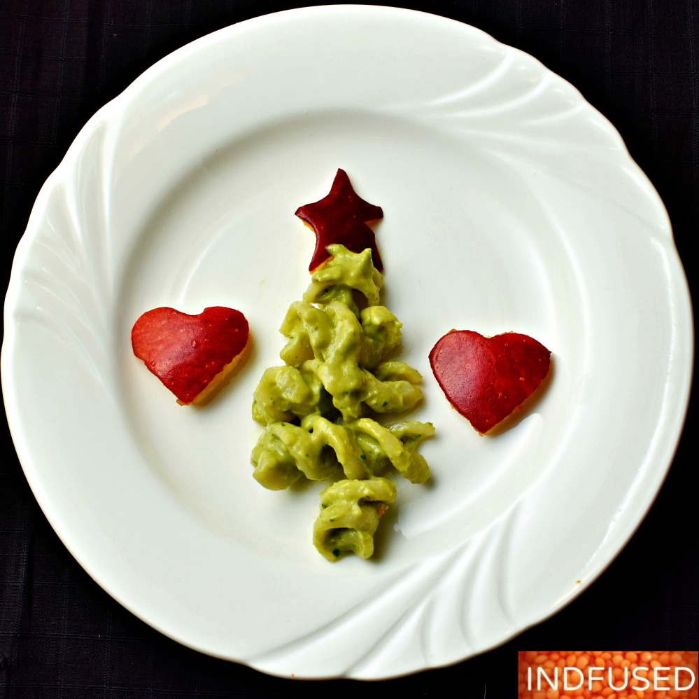 Vegetarian, gluten free, Christmas tree appetizers made with quinoa fusilli in avocado sauce