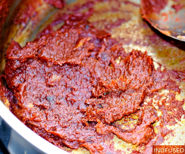 Step 5 - tomato paste and the creole seasoning cooked to give the stew its deep color and flavor!
